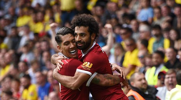 Mohamed Salah, right, celebrates scoring Liverpool's third goal with team-mate Roberto Firmino