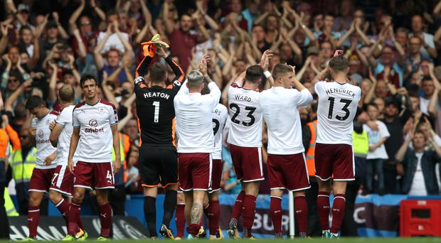 Burnley players celebrate in front of their travelling support