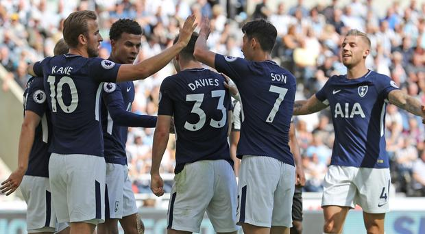 Tottenham Hotspur's Ben Davies celebrates scoring his side's second goal of the game with team mates during the Premier League match at St James' Park, Newcastle.