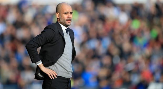 Manchester City manager Pep Guardiola,pictured, has added Nigerian striker Larry Kayode to his squad before loaning him to Girona