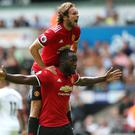 Romelu Lukaku (bottom) celebrates his goal in a resounding win over Swansea