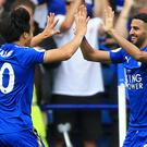 Shinji Okazaki, left, celebrates opening the scoring with Riyad Mahrez