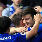 Leicester's Harry Maguire (right) celebrates his goal in the Foxes' 2-0 win over Brighton.