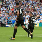 Aaron Mooy, right, blasts in Huddersfield's winner