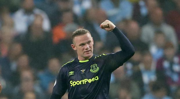 Wayne Rooney scored his 200th Premier League goal in Everton's draw at Manchester City