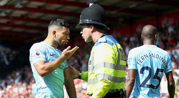 Manchester City's Sergio Aguero, pictured left, denies an allegation of assault, which Dorset Police are investigating