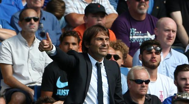 Chelsea head coach Antonio Conte is seeking reinforcements before the end of the summer transfer window but is committed to the club