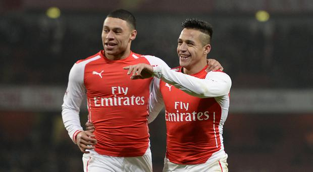 Arsenal duo Alexis Sanchez, right, and Alex Oxlade-Chamberlain, left, could be on the move before transfer deadline day