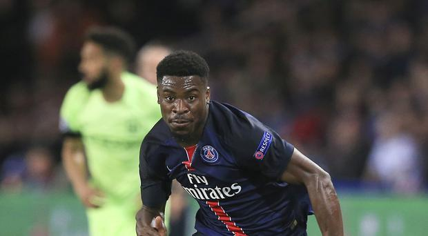 Paris Saint-Germain's Serge Aurier is closing in on a move to Tottenham.