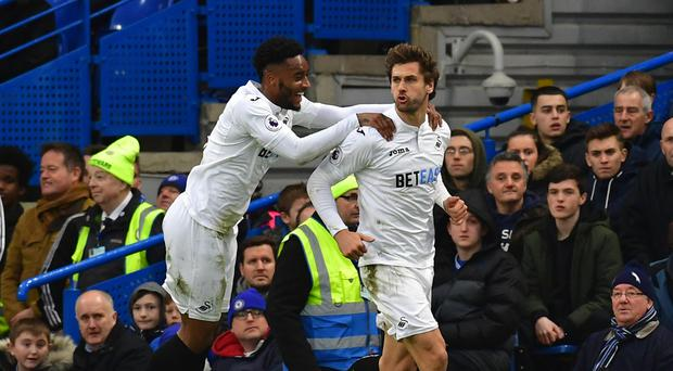 Swansea striker Fernando Llorente, right, is a transfer target for Premier League champions Chelsea