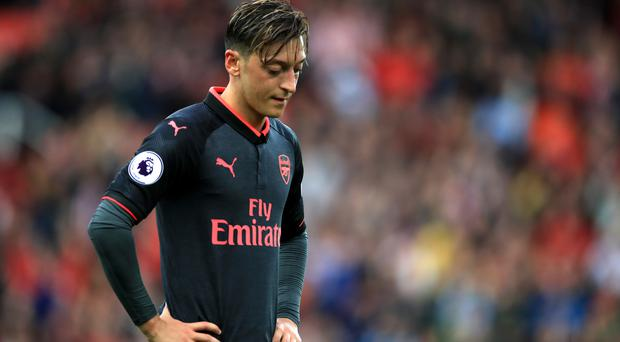 Mesut Ozil joined Arsenal four years ago