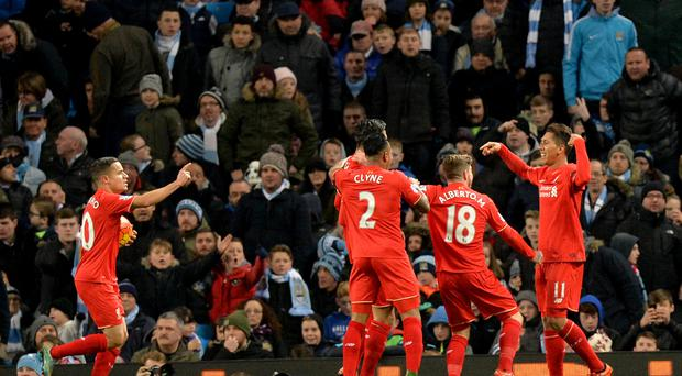 Liverpool's Roberto Firmino, far right, celebrates his goal against City in 2015