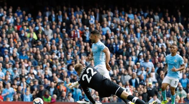 Sergio Aguero opens the scoring for Manchester City against Liverpool