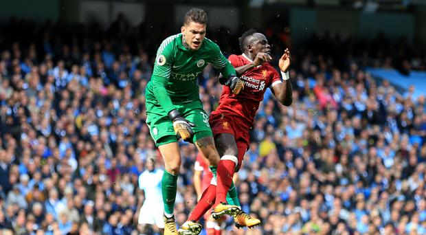 Sadio Mane, pictured right, collided with Manchester City goalkeeper Ederson, left