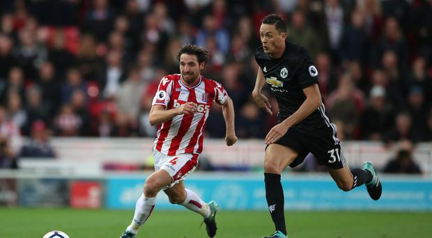 Nemanja Matic, pictured right, says Manchester United need to win at places like Stoke to be crowned champions