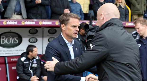 Frank de Boer and Sean Dyche shake hands before the match