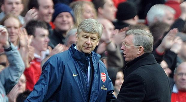 Arsenal manager Arsene Wenger, left, insists he was never tempted to replace rival Sir Alex Ferguson at Manchester United