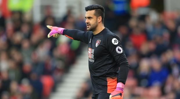 Australian goalkeeper Adam Federici has returned to Bournemouth after suffering a knee injury which requires surgery