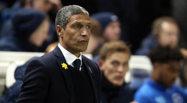Brighton boss Hughton always with one eye on the table