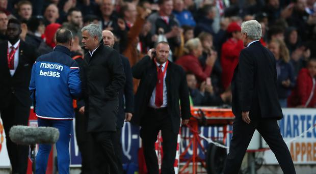Mark Hughes, pictured right, feels too much was made of his spat with Manchester United boss Jose Mourinho, left