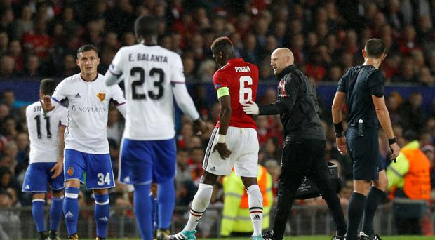 Manchester United's Paul Pogba (centre) limps off with a hamstring injury against Basle