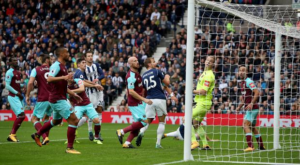West Brom's Gareth Barry, centre left, glances a header over in their 0-0 draw against West Ham