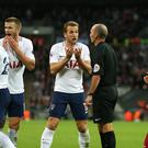 Referee Mike Dean was unmoved when Spurs called for a penalty