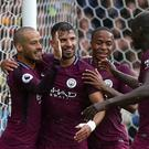 Sergio Aguero, centre left, celebrates his second goal