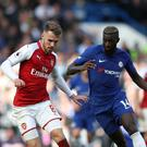 Arsenal's Aaron Ramsey, left, and Chelsea's Tiemoue Bakayoko battle for the ball during the Premier League match at Stamford Bridge
