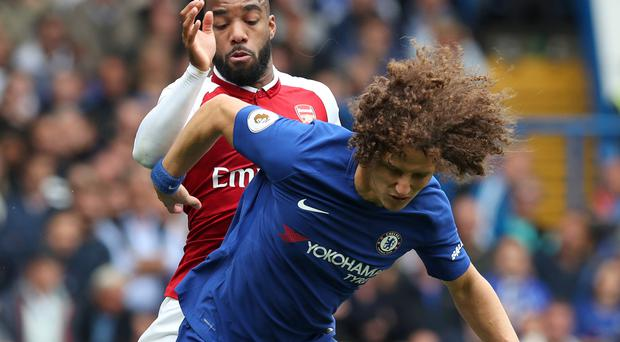 Chelsea head coach Antonio Conte felt David Luiz, pictured front, was fouled before he was sent off against Arsenal
