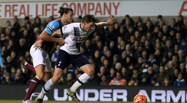 Jan Vertonghen, right, is expecting a battle with West Ham's Andy Carroll, left, on Saturday