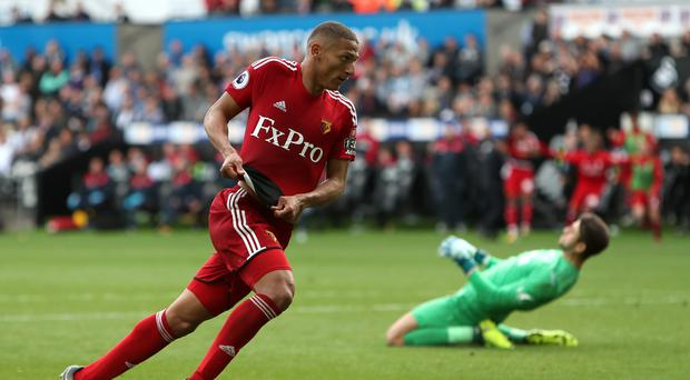 Watford's Richarlison celebrates his side's winner in their 2-1 Premier League victory at Swansea.