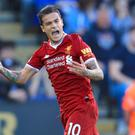 Liverpool's Philippe Coutinho celebrates his goal in their 3-2 win at Leicester.