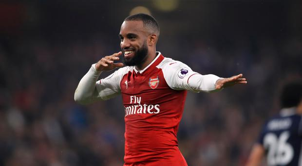 Alexandre Lacazette scored twice as Arsenal beat West Brom