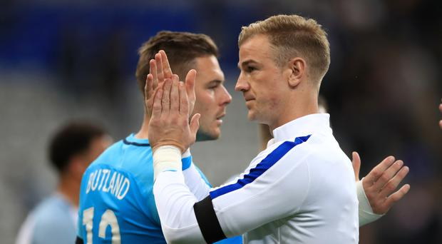 Joe Hart, right, has started all of England's World Cup qualifiers so far