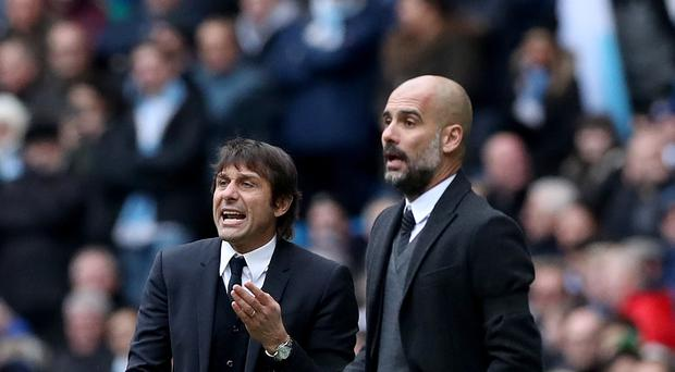 Pep Guardiola, pictured right, takes his Manchester City side to Chelsea on Saturday to play against Antonio Conte's Premier League champions