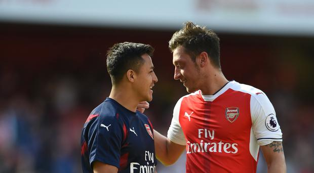 Both Alexis Sanchez (left) and Mesut Ozil will be out of contract with Arsenal in 2018