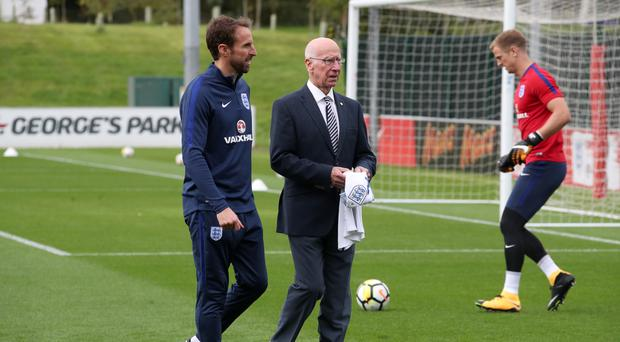 Sir Bobby Charlton, centre, pictured with England manager Gareth Southgate