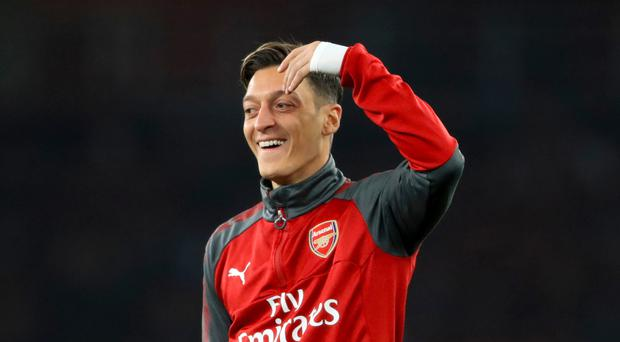 Midfielder Mesut Ozil has yet to sign a contract extension with Arsenal