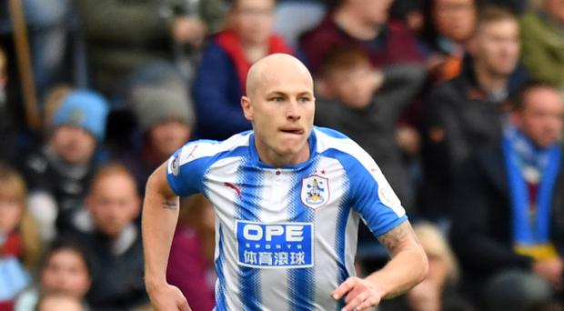 Aaron Mooy has racked up the air miles this week