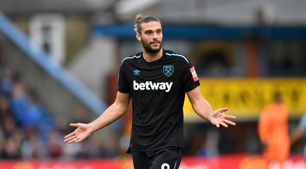 Andy Carroll, pictured, was criticised by manager Slaven Bilic after being sent off at Burnley
