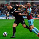 Bad start: West Ham's Marko Arnautovic (left) who was taken off after Andy Caroll's red card battles with Burnley's Steven Defour