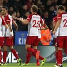 West Brom's Nacer Chadli, second left, celebrates scoring his side's goal in the draw at Leicester
