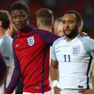 Nathan Redmond is consoled by Demarai Gray after his missed penalty saw England Under-21s lose to Germany at Euro 2017