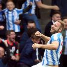 Huddersfield's Laurent Depoitre celebrates scoring against Manchester United