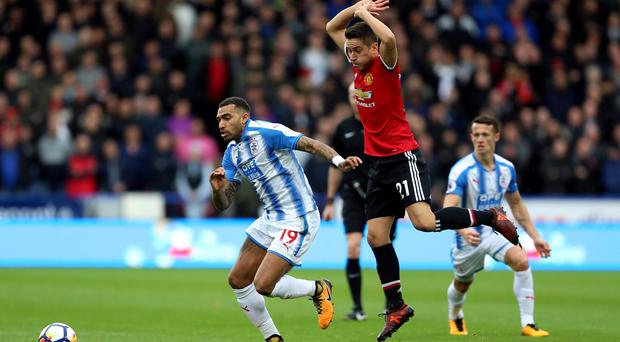 Ander Herrera, with his arms raised, was in the Manchester United side stunned on Saturday at Huddersfield