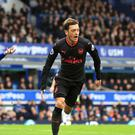 Arsenal's Mesut Ozil celebrates scoring his side's second goal in the win at Everton