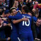 Chelsea's Cesar Azpilicueta (left) celebrates scoring his side's third goal against Watford with team-mate Eden Hazard