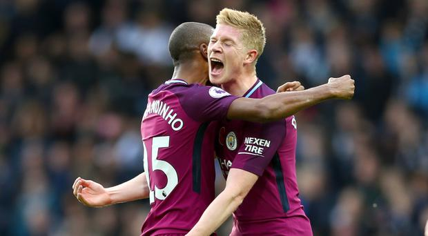 Kevin De Bruyne, right, celebrates Manchester City's second goal