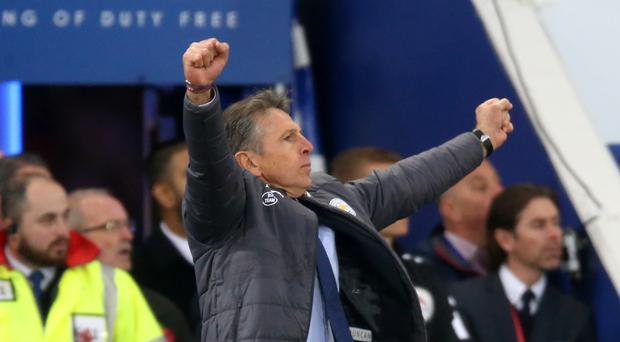 New Leicester manager Claude Puel celebrates the Foxes' second goal in their win over Everton on Sunday.